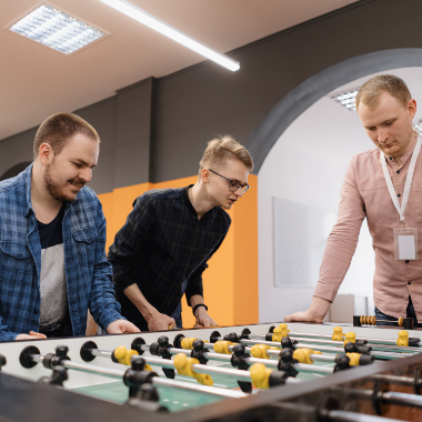 young-office-workers-playing-table-soccer-ZQ9VELY.png